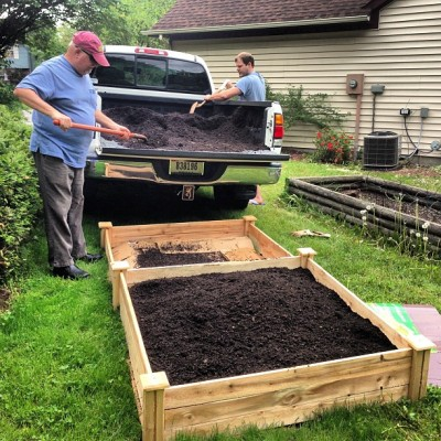 Dave & Joe fill my raised-bed garden.